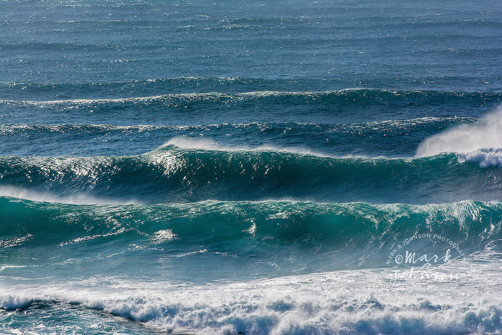 Offshore breeze grooms a big swell of Frenchman's Beach, Point Lookout, North Stradbroke Island, Queensland, Australia