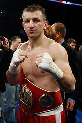 Feb 27, 2009; Newark, NJ, USA; Tomasz Adamek (red/white) and Johnathon Banks (gold) trade punches during their 12 round IBF Cruiserweight championship fight at the Prudential Center.  Adamek won via 8th round KO.