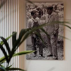 """Portrait du poete Rene Char. Affiche de Mai 68. """"Comment gouverne... Emmanuel Hoog"""", president de l'Institut National de l'Audiovisuel (INA). Bry-Sur-Marne, France. 7 janvier 2010. Photo : Antoine Doyen pour Challenges. Tous droits reserves."""