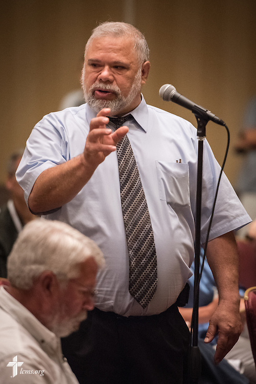 """The Rev. Michael Wolff, pastor of Our Redeemer Lutheran Church in Elwood, Neb., speaks at the open hearing of Floor Committee #13 """"Routes to Ministry"""" during the 66th Regular Convention of The Lutheran Church–Missouri Synod on Saturday, July 9, 2016, in Milwaukee. LCMS/Michael Schuermann"""
