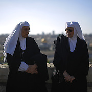 Christian pilgrims participate in the traditional Palm Sunday procession on the Mount of Olives, overlooking Jerusalem's Old City, Sunday, March 24, 2013. Palm Sunday commemorates Jesus Christ's triumphant entry into Jerusalem, and is the start of the Christian Holy Week.