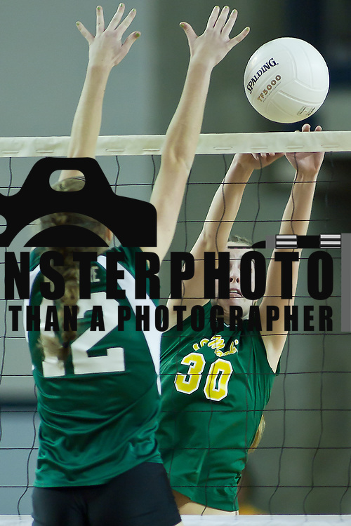 11/13/11 Newark DE: St. Mark's Abbie Mirabella #30 spikes the ball as Archmere defender Megan Carney tried to block the ball during their 2011 State Championship.<br /> <br /> St. Mark's defends their state title by defeating Archmere in three straight sets in front of fans at The Bob Carpenter on Sunday Nov. 13, 2011 in Newark Delaware.<br /> <br /> Special to The News Journal/SAQUAN STIMPSON