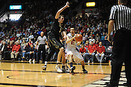 Mississippi's Marshall Henderson (22) vs. Vanderbilt forward Luke Kornet (3) in Oxford, Miss. on Saturday, March 8, 2014. (AP Photo/Oxford Eagle, Bruce Newman)