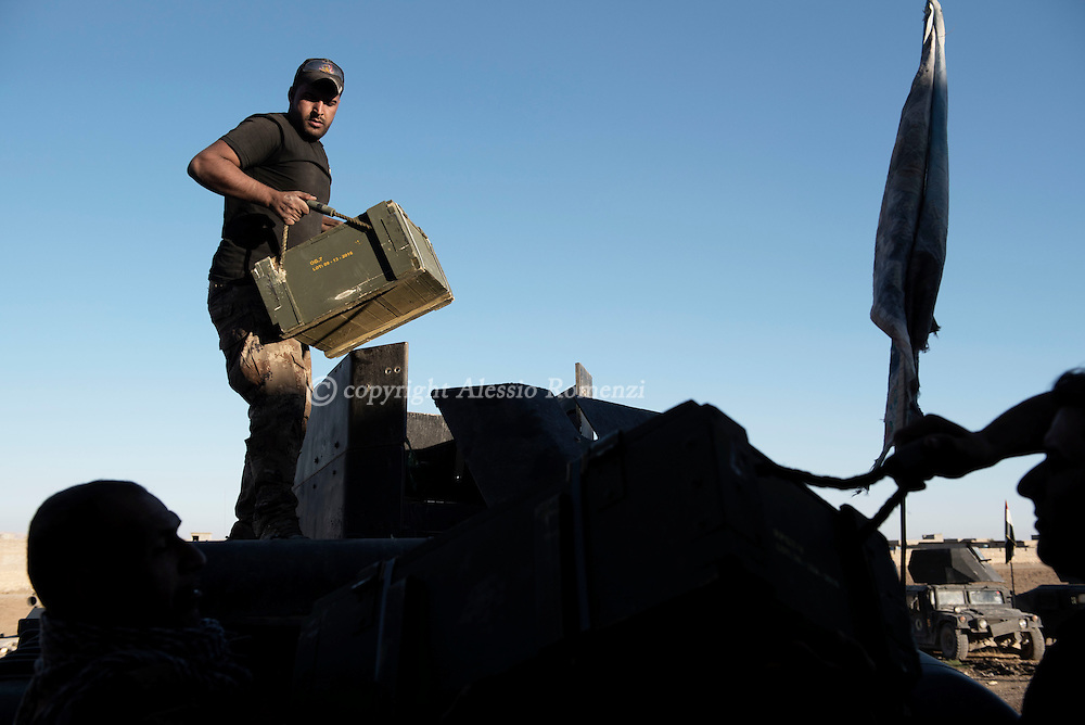 Iraq, Bazwaia: Iraqi special forces soldiers unload boxes of ammunitions inside their base. Alessio Romenzi
