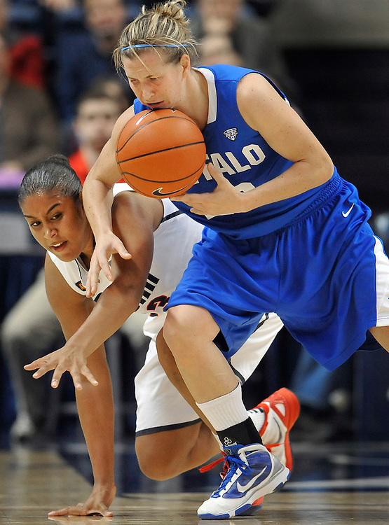 Connecticut's Kaleena Mosqueda-Lewis, left and Buffalo's Brittany Hedderson, right, battle for the ball during the first half of an NCAA college basketball game in Storrs, Conn., Saturday, Nov. 26, 2011.   (AP Photo/Jessica Hill)
