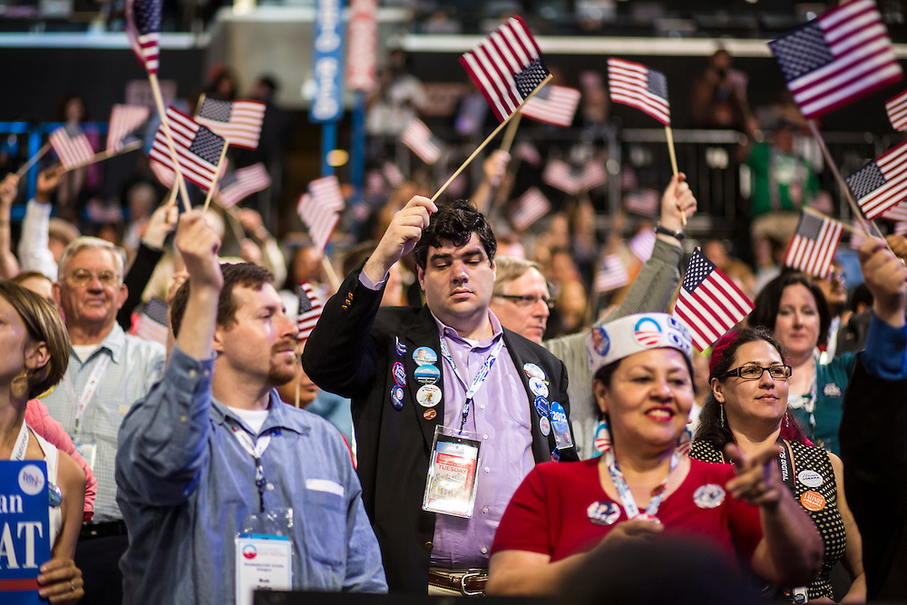 Audience members wave flags at the Democratic National Convention on Tuesday, September 4, 2012 in Charlotte, NC.