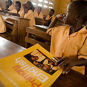 Girl holding English workbook during class at the Ying Anglican Primary School in the Savelugu-Nanton district, northern Ghana on Monday June 4, 2007.