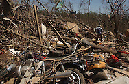 Rainsville, Alabama: Shane Spillmen, from Fort Payne, helps a neighbor sift through a valley of debris in this rural northeastern Alabama town. At least 32 people are confirmed dead in Rainsville and surrounding Dekalb County. (PHOTO: MIGUEL JUAREZ LUGO)