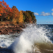 &quot;Crashing Waves in Autumn&quot;<br /> <br /> Beautiful blue skies and water with waves crashing against the rocks of Presque Isle Park in Marquette Michigan.