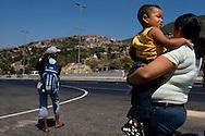 Venezuelan women wait a bus on the major bridge called viaduct #1. This bridge is the key route to the country's main airport in Venezuela. Feb 27 2008. (ivan gonzalez).