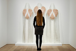 """© Licensed to London News Pictures. 25/04/2017. London, UK. A staff member views """"Die Erlösung Meiner Schwestern (The Salvation of My Sisters)"""", 1985, by Renate Bertlmann.  Launch of a new exhibition program at Sotheby's S