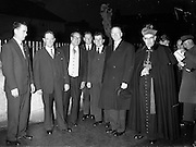 09/04/1961<br /> 04/09/1961<br /> 09 April 1961<br /> Opening of Thurles Drama Festival at Premier Hall Thurles, Co. Tipperary, organised by Muintir na T&iacute;re and Gael Linn.  The Archbishop of Cashel Thomas Morris (far right) and president de Valera (2nd from right) arrive at the Hall.