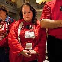 LISA JOHNSTON | lisajohnston@archstl.org  Cecelia Dachsteiner bowed her head in prayer during the Rally for Religious Liberty inside the rotunda of the Missouri State Capitol in Jefferson City, MO