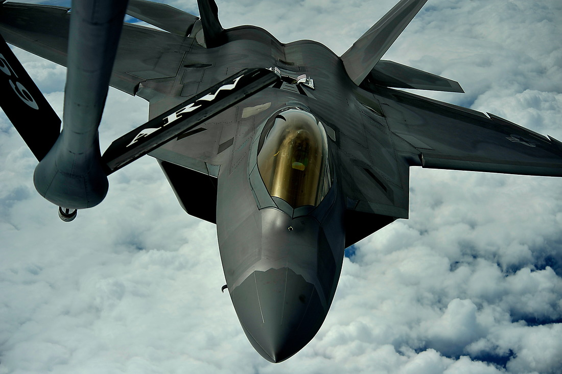 A 1st Fighter Wing's F-22 Raptor from Joint Base Langley-Eustis, Virginia, pulls into position to accept fuel from a KC-135 Stratotanker with the 459th Air Refueling Wing at Joint Base Andrews, Maryland, off the East Coast of the U.S on May 10, 2012. — © /