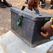 """The cashbox of a women's """"susu"""" group - an informal savings and loan club - in the village of Gbengbee in the Upper West region of Ghana. The women's activities are supported by Pognaa Tang I - a pognaa is responsible, in particular, for the wellbeing of women and children in her area of authority. While the title translates as """"woman chief"""", in practice her authority is  subject to a male chief. The role of the pognamine (plural of pognaa) is being revived after having been suppressed during the colonial era, and they are increasingly seen as a force for development."""