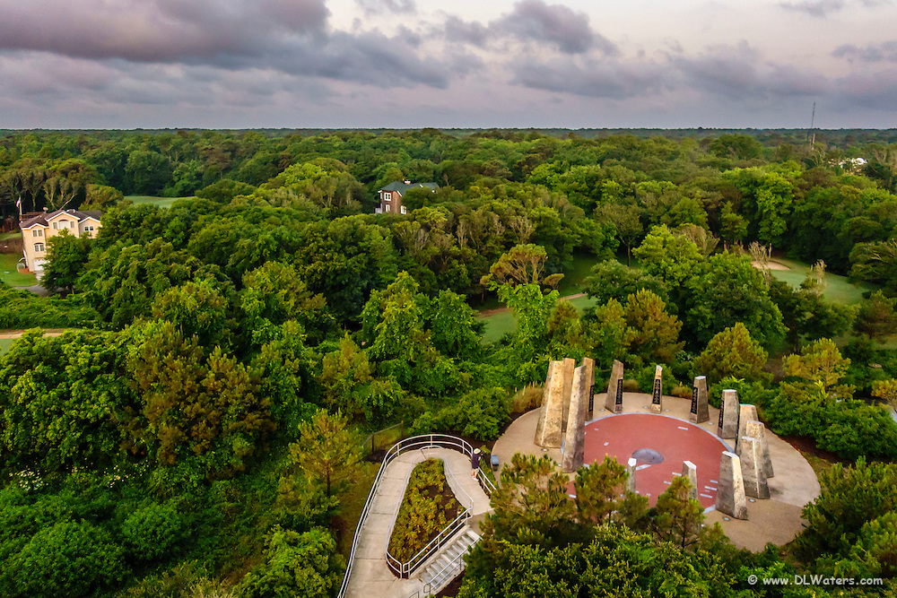 Looking down on a Monument to a Century of Flight in Kitty Hawk from an aerial perspective.