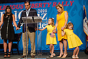 Republican presidential hopeful Sen. Ted Cruz (R-TX) prays with (from left) Naghmeh Abedini, wife of Saeed Abedini, an American citizen jailed in Iran, his daughter Caroline, 7, wife Heidi Nelson Cruz, and daughter Catherine, 4, Friday, Aug. 21, 2015, as the Cruz campaign hosts the Rally for Religious Liberty at the Community Choice Credit Union Convention Center in Des Moines, Iowa. REUTERS/Scott Morgan