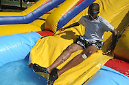 Jonathan Webb slides into water during the Juneteenth Celebration in Oxford, Miss. on Saturday, June 19, 2010.