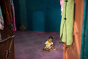 A little baby girl sits and waits for her mother. <br /> Just like maternal deaths, neonatal and child mortality rates in Pakistan are extremely high as well. <br /> One in every eleven children born in Pakistan dies before his or her fifth birthday. Karachi, Pakistan