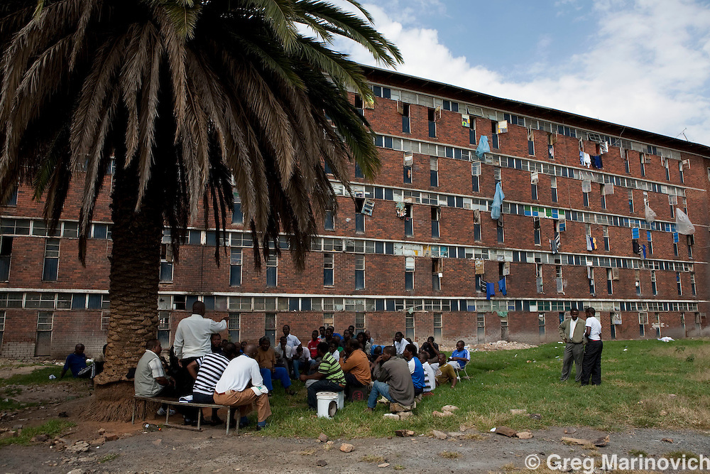 A clan meeting for male members of a clan from the Msinga area at the Zulu-dominated Madala hostel in the tiny impoverished township of Alexandra in Johannesburg is alongside Sandton, the ultra wealthy business hub of South Africa. Photo Greg Marinovich