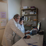 Italian doctor Pietro Gamba and his wife Margarita, in the lab room of their hospital in Anzaldo, near Cochabamba, in the Bolivian Andes