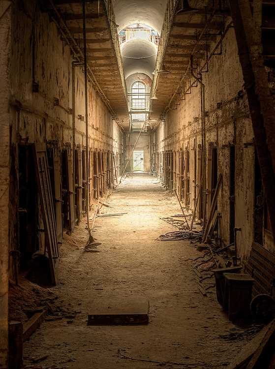 Abandoned hallway inside of Eastern State Penitentiary in Philadelphia PA.