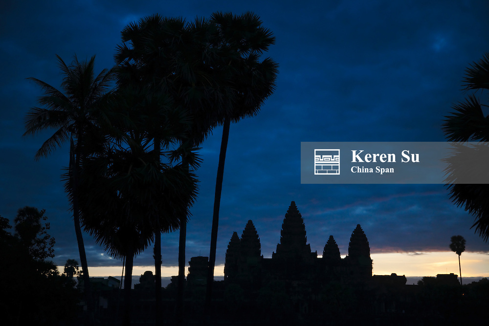 Towers of Angkor Wat in early morning, UNESCO World Heritage site.