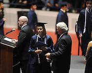 "Callie Mayo receives a diploma at the Oxford High graduation ceremony at the C.M. ""Tad"" Smith Coliseum in Oxford, Miss. on Friday, May 24, 2013."