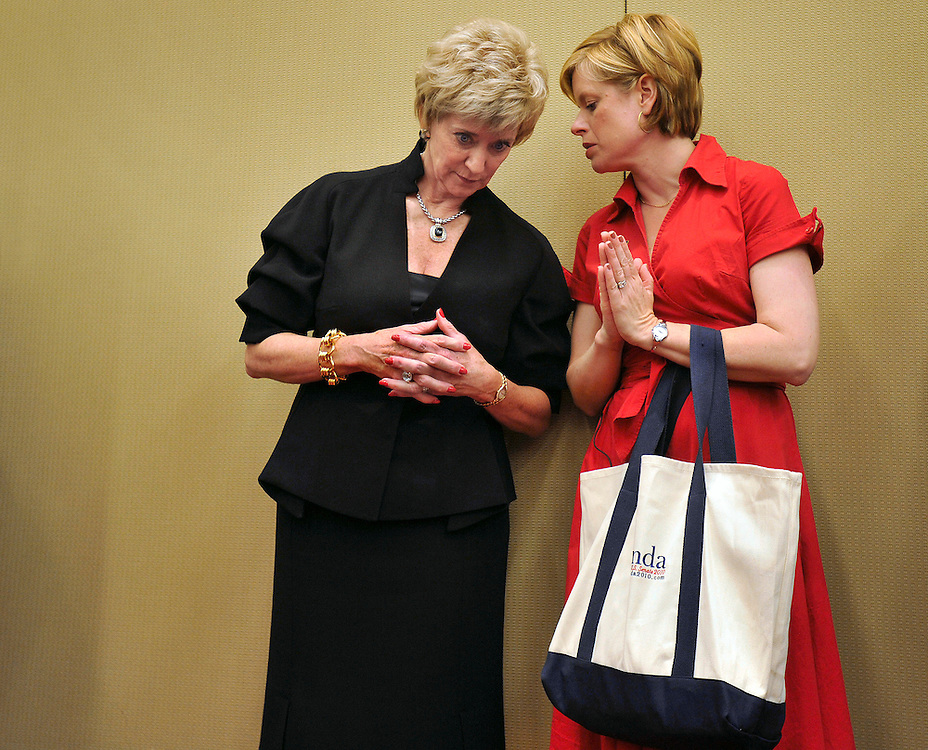 Republican candidate for U.S. Senate Linda McMahon, left, speaks with campaign aid Jodi Latina at the Connecticut Republican Convention in Hartford, Conn., Friday, May 21, 2010.  (AP Photo/Jessica Hill)