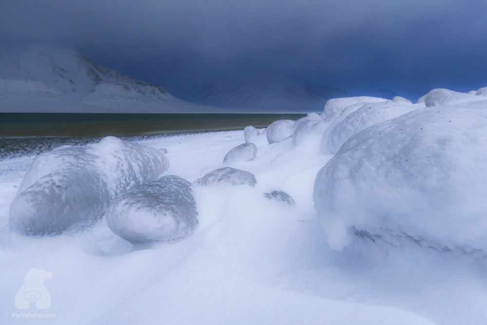 Ice and snow on the beach during the polar night in Longyearbyen, Svalbard