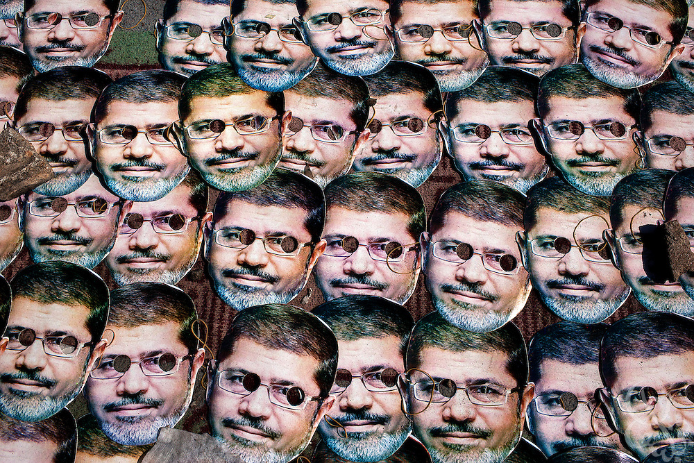 Masks of deposed Egyptian president Mohamed Morsi are seen on sale at a continuing large scale demonstration and sit-in around the Rabaah al-Adawia mosque and square in the Nasr City district of Cairo Friday July 26, 2013. Morsi's supporters are demanding the reinstatement of the deposed President and are opposed to the Egyptian military, which they say has undertaken an undemocratic coup.
