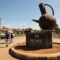 a coffee monument adorns one of the few paved roads in Jimma, (once the capital of the region known as Kaffa) in Ethiopia. Jimma is beleived to be the original birthplace of coffee.  Ethiopia boasts the most ancient and compelling traditions for coffee consumption that the world has ever seen. Coffee permeates the cultural fabric of Ethiopian life and it unites the country. It binds the many different ethnic groups together, Christian or Muslim, rich or poor. An elaborate extension to Ethiopia's warm sense of hospitality, the coffee ceremony is a daily social ritual to honour the importance of the bean, and strengthen human bonds.
