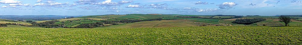 Newtimber Hill, site of an Iron Age tumulus, is part of the South Downs in Sussex, England. It is close to the long distance footpath, the South Downs Way. The view is northwards over the Sussex Weald.