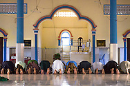 Cham muslim men pray in a small village mosque on the countryside near Kompong Cham, Cambodia.