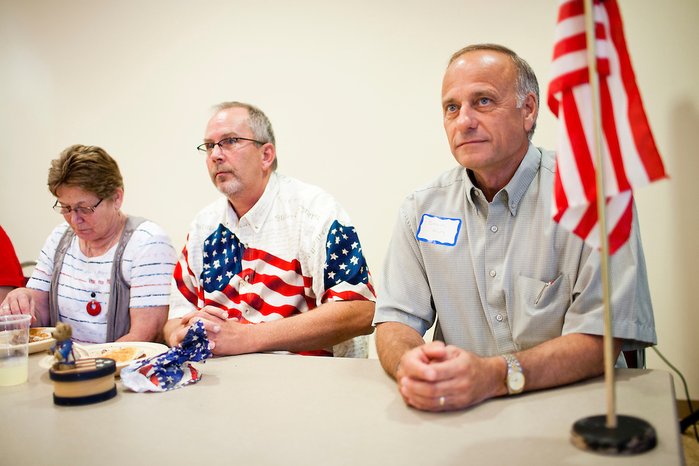 Rep. Steve King (R-IA), right, is introduced before speaking at a Calhoun County Republican Party dinner during a campaign stop by Republican presidential candidate Rep. Michele Bachmann (R-MN) on Monday, August 8, 2011 in Rockwell City, IA.