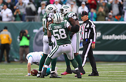 Oct 28, 2012; East Rutherford, NJ, USA; Miami Dolphins quarterback Ryan Tannehill (17) is sacked by New York Jets outside linebacker Calvin Pace (97) during the first half at MetLIfe Stadium.