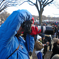 Andrew Lightman takes a photo at President Obama's Inauguration.
