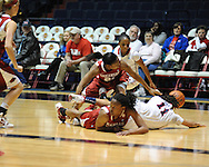 "Arkansas' Ashley Daniels (12), Arkansas' Dominique Robinson (21), and Ole Miss' Kenyotta Jenkins (11) and Valencia McFarland (3) go for the ball at the C.M. ""Tad"" Smith Coliseum in Oxford, Miss. on Thursday, January 12, 2012."