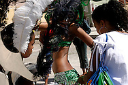 Girls preparing their costumes before parading in Mindelos Tuesday Carnival March.
