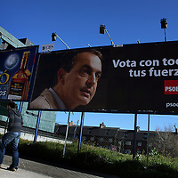 A  pedestrian walks past an election poster for Jose Luis Rodriguez, Spain's prime minister and leader of the Socialist Party, in Madrid, Spain, on Thursday, March 6, 2008.