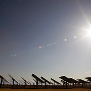 The PS10 solar tower plant sits at Sanlucar la Mayor outside Seville on April 29, 2008 in Seville, Spain. The solar tower plant, the first commercial solar tower in the world, by the Spanish company Solucar (Abengoa), can provide electricity for up to 6,000 homes. Solucar (Abengoa) plans to build a total of 9 solar towers over the next 7 years to provide electricity for an estimated 180,000 homes.