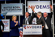 """Hillary Clinton, Gov. Martin O'Malley, Sen. Harry Reid and Sen. Bernie Sanders stand before supporters for the Nevada State Democratic Party """"Battle Born / Battleground"""" First in the West Caucus Dinner at The MGM Grand on Wednesday, January 6, 2015.  L.E. Baskow"""