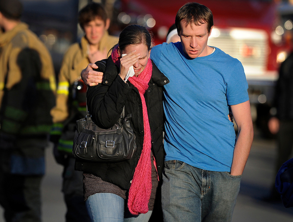 Alissa and Robbie Parker leave the firehouse after learning their six year old daughter, Emilie was killed in Sandy Hook Elementary School shooting. (AP Photo/Jessica Hill)