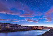 The ISS (International Space Station) rising out of the west over the Red Deer River, near the Atlas Coal Mine site (the source of the streetlight here), in the evening twilight, October 10, 2015. <br /> <br /> This is a single 30-second exposure at f/2.5 with the Sigma 24mm lens and Nikon D750 at ISO 1600.