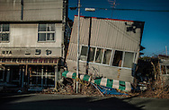 Like stepping back in time:  Entering Tomioka, part of the government nuclear exclusion or no-entry zone, had that designation lifted in March 2013, but it remains too radioactive for human habitation.  Tomioka can feel like Fukushima in the immediate aftermath of the earthquake and tsunami almost 5 years ago.  This is earthquake damage, not tsunami damage.  Tomioka, Fukushima Prefecture, Japan.
