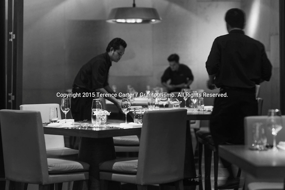 The Grand Gelinaz! Shuffle on July 9th 2015 Noma at Nahm, Bangkok<br /> <br /> Staff briefings over, the floor staff took time to do a final check of the room before guests arrived. Executive Chef Chris Miller said that once foodies started to guess who was coming to cook, the phones ran hot. He could have filled the room several times over and chefs were begging him to let them come and work in the kitchen while the Noma chefs were here. Copyright 2015 Terence Carter / Grantourismo. All Rights Reserved.