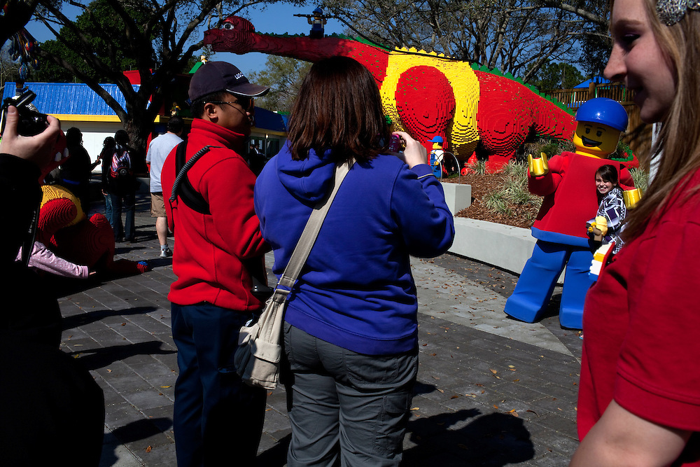 Staff welcome the public as they walk through the entrance and have their photos taken in Fun Town in Legoland in Whitehaven, Florida on February 11, 2012.