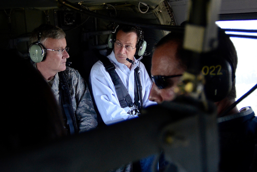 Connecticut Gov. Dannel P. Malloy, center, examines damage from Tropical Storm Irene in a helicopter with Adjutant General Thaddeus Martin, left, near Simsbury, Conn., Monday, Aug. 29, 2011.  (AP Photo/Jessica Hill)