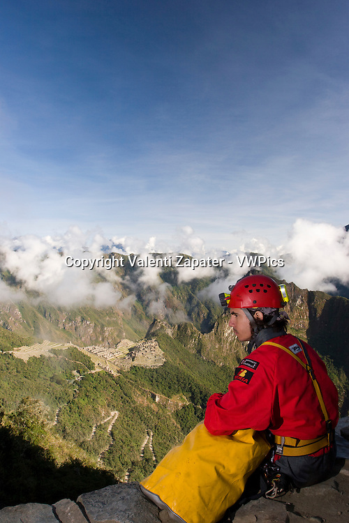 Caver seeing Machu Picchu from Intipunku (sun's gate). Cusco, Peru