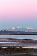 Earth's Shadow (the belt of venus) over Mount Blandshard (The Golden Ears) and Mount Robbie Reid. Photographed from Crescent Beach's Blackie Spit in Surrey, British Columbia, Canada